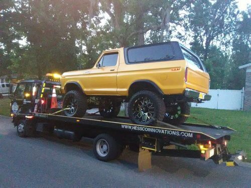 Towing a Classic yellow jeep in jacksonville